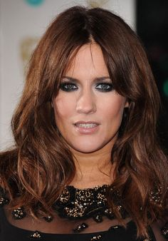 Caroline Flack goes for deep brunette and dark eyes at the BAFTAs - and we think she looks great!