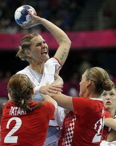 Miranda Tatari (2) and Sonja Basic of Croatia try to stop Katarina Bulatovic of Montenegro, top, during their women's handball preliminary match at the 2012 Summer Olympics, Friday, Aug. 3, 2012, in London.