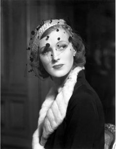 Beauty of the day  Model in straw beret featuring velvet spotted 'voilette', 1936