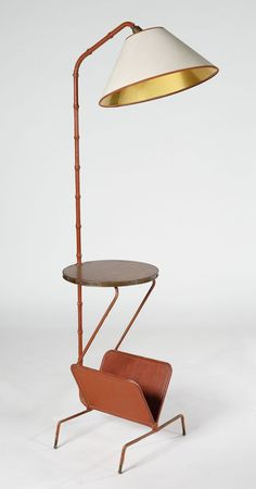 Jacques Adnet; Leather over Wood, Brass and Wood Floor Lamp with Integrated Table and Magazine Rack, 1950s.