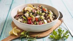 Roasted potatoes are tossed into this appealing version of Greek salad. Serve it as a side dish for grilled lamb, kebabs or spanakopita. It's also a nice salad to bring to a summer potluck. Baby Potato Salad, Summer Potluck, Grape Salad, Grilled Lamb, Large Salad Bowl, Roasted Potatoes, Side Dishes, Dinner, Salads