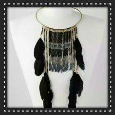 "⚫BOHEMIAN FEATHER STATEMENT COLLAR NECKLACE ⚫ STUNNING  BOHEMIAN BOHO STYLE  DECADENT COLLAR  NECKLACE  WILL TURN HEADS. GOLD TONE  COLLAR DRIPS WITH BEADED MULTI COLORED  FRINGE, TOPPED OFF WITH  BILLOWING  BLACK  FEATHERS. BOLD STATEMENT  PIECE .12.5 ""DROP WILL  COME NIB), ❎PLZ DO NOT PURCHASE THIS LISTING ❎♒I HAVE 2 AVAILABLE ♒PLZ COMMENT & I'LL MAKE A SEPARATE LISTING FOR YOU TO PURCHASE,  ( L10 BOTIQUE  Jewelry Necklaces"