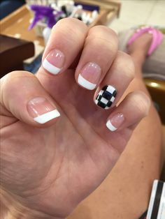 Racing checkered flag nail art.