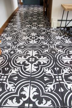 Excellent information about painting tile floors plus contact info for the stencils, etc.