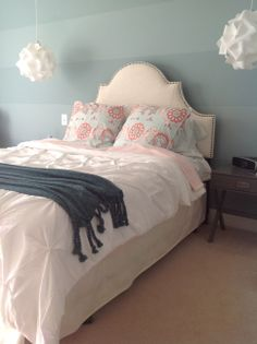 IN PROGRESS - Tween Girl room detail...teal, coral, raspberry accents with touches of gray, medium blue walls, talc upholstered headboard,  origami pendant lights, wide striped accent wall, Serena and Lily shams, by mcubed interiors