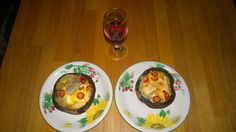 Broiled Portabella caps filled with egg with sea salt, fresh oregano, and topped with thinly sliced cherry tomatoes and mozzarella. Filling, tasty, and very easy