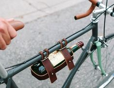 The Leather Bicycle Wine Carrier by Fyxation is a perfect addition to a fun car-free lifestyle and a great gift for cyclist who has everything!
