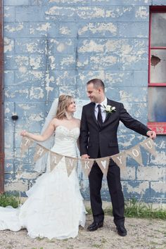 """A simple """"thank you"""" banner made this couple's wedding photo super cute! Wedding Couple Photos, Wedding Couples, Bridal Gowns, Wedding Dresses, Allure Bridal, Newlyweds, Summer Wedding, Real Weddings, Hair Makeup"""