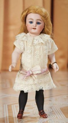 All-Bisque Black-Stocking Doll, 886, Simon and Halbig sold for $1900 (Theriault's Jan.2015) 22 cm Bisque swivel head on kid-edged bisque torso, blue sleep eyes, painted lashes, feathered brows, open mouth, outlined lips, four porcelain teeth, mohair wig, peg-jointed bisque limbs, painted thigh-high black stockings, brown two-strap shoes, lace dress. Marks: 886 S 5 H (head) 5 (under arms). Comments: Simon and Halbig, circa 1890. Rare large size of the all-bisque doll, sought-after model.