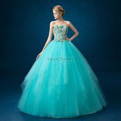 Robe de bal princesse pour soirée en tulle bleu turquoise à bustier avec pétale superposée