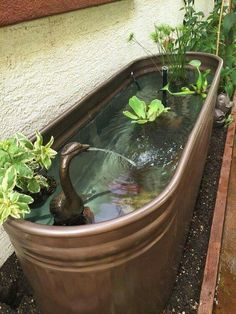 A stock tank is given a makeover with metallic copper color paint and transformed into a beautiful fountain!