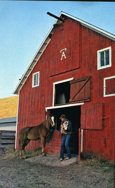 A nice rustic red horse barn!