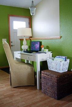Like the small table and using a box for storage next to it.