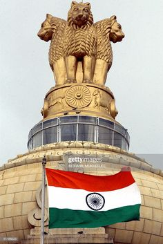 The Indian national flag flies in front of the Indian national emblem, lying atop the Vidhana Soudha State assembly in Bangalore, 14 August 2004 on the eve of India's anniversary of. Get premium, high resolution news photos at Getty Images Indian Flag Photos, Indian Flag Colors, Picture Of Indian Flag, Indian Flag Wallpaper, Indian Army Wallpapers, National Flag India, National Guard, Happy Independence Day Images, Indian Independence Day