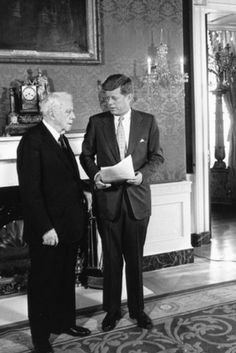 Poet Robert Frost with President John F. Kennedy. The Green Room of the White House, 1961, showing the decoration from the Truman era.