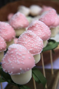 Pink marshmallow toadstools. Marshmellow+strawberry dipped in pink white chocolate+ sprinkles!