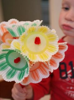 A child holding a bouquet of flowers made of cupcake liners and more cute ideas