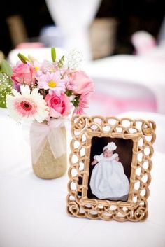 So easy to incorporate a framed photo as part of your baptism table centerpieces. The frames would be nice favors too. Use this for baby dedication . Baptism Table Centerpieces, Baptism Decorations, Simple Centerpieces, Flower Centerpieces, Birthday Decorations, Photo Centerpieces, Balloon Decorations, Christening Party, Baptism Party
