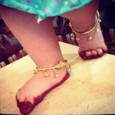 There is actually no design and effort in this mehndi art, you simply have to apply henna on toes and under feet while your baby is asleep and let your baby see the magic of red color in the morning. Mehndi Designs For Kids, Mehndi Designs Feet, Baby Jewelry, Kids Jewelry, Baby Girl Fashion, Kids Fashion, Cool Toys For Girls, Baby Bracelet, India Jewelry