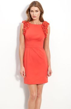 Great color! We styled this with turquoise. See the look at http://www.dressforthewedding.com/coral-dress-for-a-wedding/