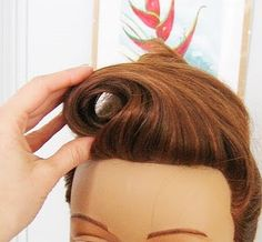 Pin up hair staple: Learn how to make a victory roll