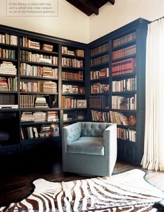 lots of black bookcases, bold graphic rug
