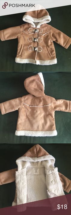 Faux shearling 3 toggle winter jacket for baby This is a faux fur/shearling baby jacket. Three toggle closure. Super cozy and warm. Perfect for winter! Great condition- like new. My son actually wore this home from the hospital in snowy February. Old Navy Jackets & Coats