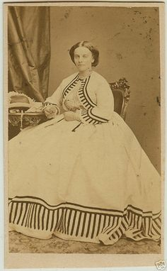 Portrait of a young woman in summer dress, c. 1860s.  She is also wearing a matching jacket.