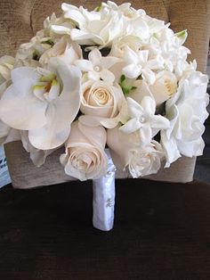Roses, Stephanotis and Orchids Bouquet - I'm so glad I'm starting to see the Stephanotis everywhere now, I just want a whole bunch of those.