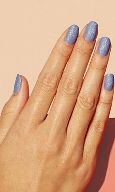 Glittery flakes are a fun new twist on sparkle. Add them to a chic matte lavender nail polish for a multidimensional sheen that's fit for a princess.