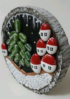 Painted pebbles on log