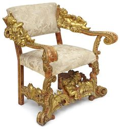 An Italian Baroque style giltwood armchair in the manner of Brustolon, late 19th century -  Of bold proportions, the rectangular upholstered back issuing wide swept arms carved with figures of putti reclining on floral clouds with dramatic volute scrolled terminals, the foliate carved outset legs joined by a stretcher carved as a putto holding a bouquet. height 37in (94cm); width 36in (91cm); depth 23in (58cm)