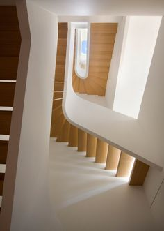 The White Snake by Space4architecture is a curving white staircase added to a New York townhouse