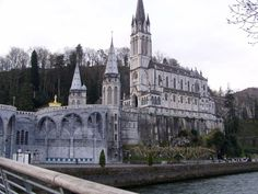 Lourdes in France- devotees believe the spring water found in the grotto of Our Lady of Lourdes can heal any illness