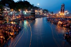 India's holiest river, the Ganges, is scribbled with light from floating oil lamps during the Ganga Dussehra festival in Haridwar. Hindus near death often bathe in the river; some are later cremated beside it and have their ashes scattered on its waters. (John Stanmeyer, VII, © National Geographic) #