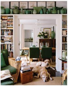 Bookshelves flanking door with shelf above