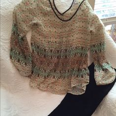 Price DropBoho Blu-Pepper sheer top..size S Really pretty Boho top in a sheer fabric... Size small. Will need a cami or bando underneath. Really cute with shorts and wedges. Colors are brown, green, peach and white. Blu Pepper Tops Blouses