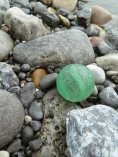 August 1, 2013 along the French Shore near Port Saunders, Newfoundland: ~submitted by Sarah Reid from Fort McMurray, Alberta, Canada I was so excited to find this beach glass marble!  This beach is known for small to