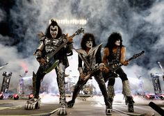 Gene Simmons, left, Tommy Thayer and Paul Stanley of KISS perform during intermission of an NHL game in January 2017.