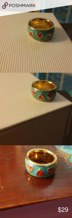 COACH ring. Hearts with aqua and gold !! I believe it is a size 6. One of a kind, delightful ring. Not over powering. Just sweet and different. Nice to wear over the holidays and then all year really. Made by COACH so you know it is quality. A nice ring to add to any jewelry collection. Coach Jewelry Rings