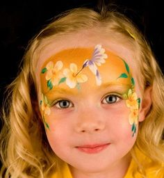 Hummingbird and flowers on golden yellow background Face painting