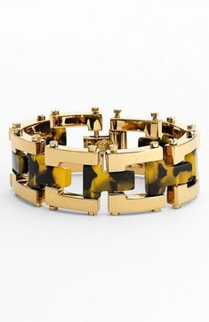 Link bracelets are always in! Love the mix of gold and tortoise.