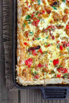 Italian Breakfast Strata with Fillo Crust | The Mediterranean Dish. Easy Italian egg casserole with layers of goodness! Flaky, crispy fillo (phyllo) dough crust, topped with a fluffy egg mixture filled with Italian favorites like chicken sausage, bell peppers, sun-dried tomato and more. The best egg casserole ever! See the easy tutorial and recipe on TheMediterraneanDish.com