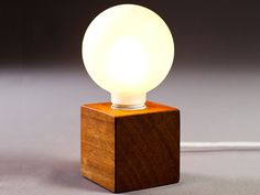 This gorgeous solid wood lamp is simple, modern and cool.