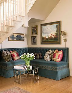 Love this banquette perfectly fitted under the stairs in what would be such an awkward wasted space. Lovely.