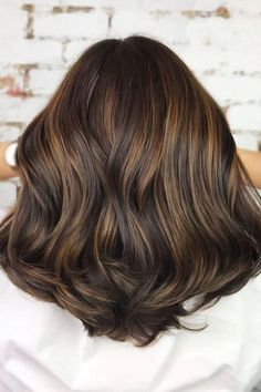 Hair Color Trends That'll Make 2018 Absolutely Brilliant for Brunettes | Cue the oohs and ahs. Once you get the itch to change up your hair color, it's hard to resist a few strokes of honey here, a few ribbons of caramel there. While brunettes haven't always gotten to cash in on trending shades like platinum and pastel, we're finally seeing a whole fresh fleet of hair color trends for brunettes that are anything but boring. Luckily, there are enough brilliant brunette shades to go around.