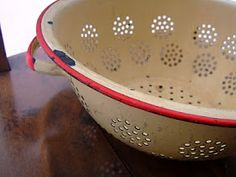 A well aged enamel colander.  One of my favorite color schemes in enamelware.