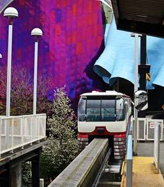 Seattle Monorail with the EMP behind. (Experience Music Project) The monorail goes from Westlake Center downtown to the Seattle Center at the foot of Queen Anne Hill.