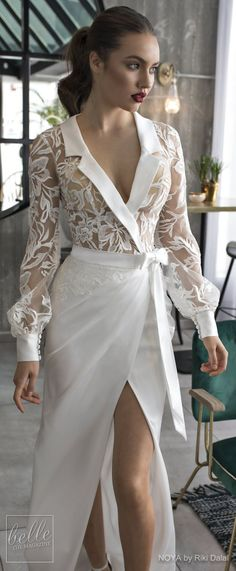NOYA By Riki Dalal Wedding Dress Spring 2019 : Forever Bridal Collection | Unique bridal gown wrapped coat with long bishop sleeves collar two piece vintage sheath wedding dress. #weddingdress #weddingdresses #bridalgown #bridal #bridalgowns #weddinggown #bridetobe #weddings #bride #weddinginspiration #weddingideas #bridalcollection #bridaldress #fashion #dress See more gorgeous bridal dresses by clicking on the photo