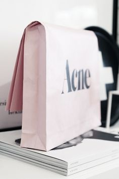 I like this idea. I am not sure what acne has to do with it however I think this could be good for a shopping piece of design or something similar. I like how they folded the bag and made it seem like there is something in it. sarah t Fashion Packaging, Bag Packaging, Print Packaging, Fashion Branding, Packaging Design, Branding Design, Product Packaging, Clothing Packaging, Fashion Typography